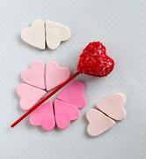 Red cakepop with hearts, blue background Stock Photos