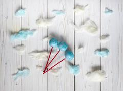 Blue cakepops among the candy-floss clouds Stock Photos