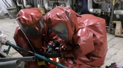 Firefighters practice sealing leak accident corrosive toxic hazardous material Stock Footage