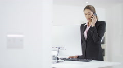 4K Smiling Arab businessman & Western businesswoman looking at computer in offic - stock footage