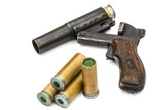 Cartridge is inserted into the barrel  flare gun, isolated on white backgroun - stock photo