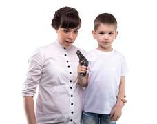 Little boy with the gun - stock photo