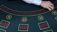 Stock Video Footage of Croupier dealing cards in a poker game table, slow motion