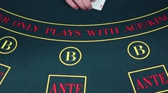 Stock Video Footage of Croupier deals cards on a poker game table, slow motion