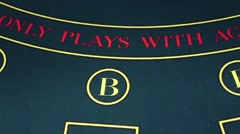 Stock Video Footage of Croupier deals two cards over poker game table, slow motion
