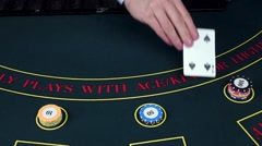 Stock Video Footage of Croupier deal cards on table with chips, casino, slow motion