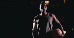 Basketball Player Holding Basketball on Hip in Night - stock footage