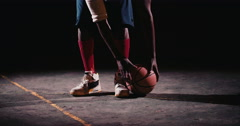 Basketball Players Feet and hand on ball, court ground Stock Footage