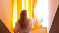 Young woman opening window Stock Footage