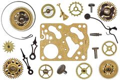 Spare parts for clock. Metal gears, cogwheels and other details - stock photo