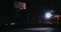 Empty Inner-City Basketball Court in the Night Stock Footage