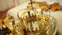 Close up of two gold wedding crowns prepared for ceremony  of marriage in a Stock Footage