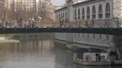 Tourists walking on the Butchers' Bridge in Ljubljana Stock Footage