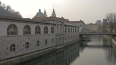 Ancient roman style building by the Ljubljanica River in Ljubljana Stock Footage