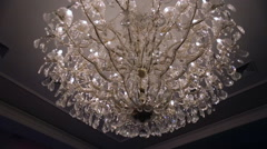 Beautiful retro luxury crystal strass chandelier isolated on a white wall of the Stock Footage