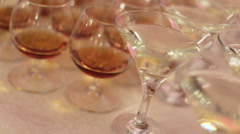 Luxury glasses full of different expensive alcohol inside prepared for the - stock footage