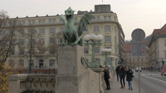 Girls walking and looking at the river from Dragon Bridge in Ljubljana Stock Footage