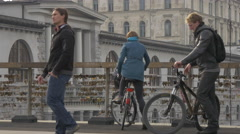 Pedestrians crossing a bridge in Ljubljana Stock Footage