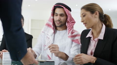 4K Arab business group in meeting, signing contract for a property deal - stock footage