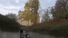 Dads with strollers taking a walk in Trubar park in Ljubljana Stock Footage