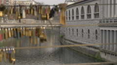 Traffic on Dragon Bridge seen through the padlock rows in Ljubljana Stock Footage