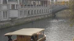 Wooden boat and kayaks floating on Ljubljanica River in Ljubljana Stock Footage