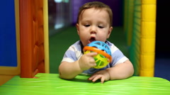 Baby play with toy in playground Stock Footage