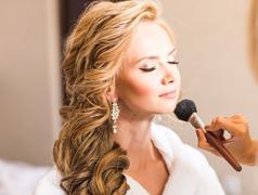 Wedding makeup artist making a make up for bride. Beautiful sexy model girl Stock Photos