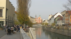 Tourists relaxing on the riverside in Ljubljana Stock Footage