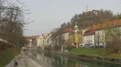 Woman walking on Ljubljanica Riverside in Ljubljana Stock Footage
