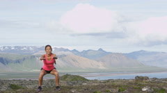 Fitness girl exercising outdoors doing squat - healthy lifestyle woman workout Stock Footage