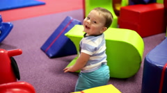 Stock Video Footage of Smiling baby on playground
