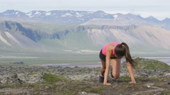 Fitness woman exercising doing mountain climbers - girl doing doing exercises - stock footage