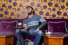Man Smoking The Traditional Hookah Stock Photos