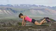Push-ups fitness woman doing pushups and mountain climbers outside in nature Stock Footage
