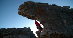 Rock climber bouldering outdoors on mountain in nature Stock Footage