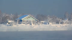 Houses on the river Bank in winter in the snow Stock Footage