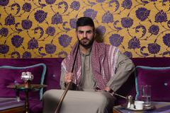 Islamic Man Smoking Shisha In The Arabic Cafe Stock Photos