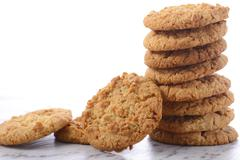 Traditional ANZAC Biscuits on White Background Stock Photos