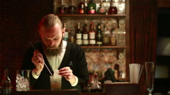 Handsome barman professional at posh bar making cocktail drinks Stock Footage
