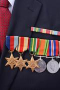 Original Australian Army WWII medlas pinned to suit. Stock Photos