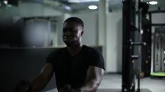 Athlete Uses Cable Machine at Gym Stock Footage