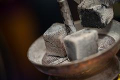 Preparation The Hookah With Charcoal For Smoking - stock photo