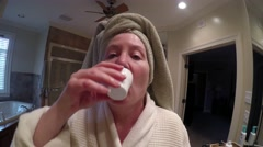 Mature Woman Using Mouthwash Stock Footage