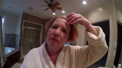 Mature Woman using straight iron Stock Footage