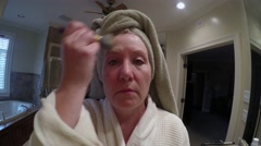 Mature Woman Powdering Face Stock Footage