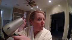 Mature Woman Drying Hair Stock Footage