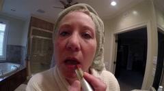 Mature Woman Applying Lipstick Stock Footage