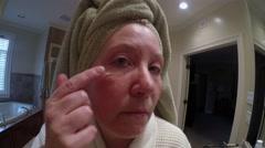 Mature Woman Applying Foundation Stock Footage