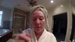 Mature Woman Applying Blush - stock footage
